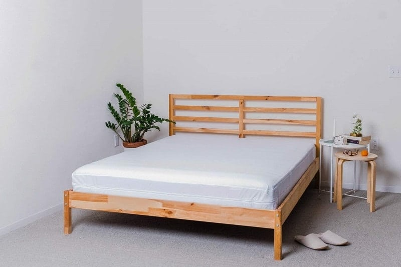 wooden bed with white mattress