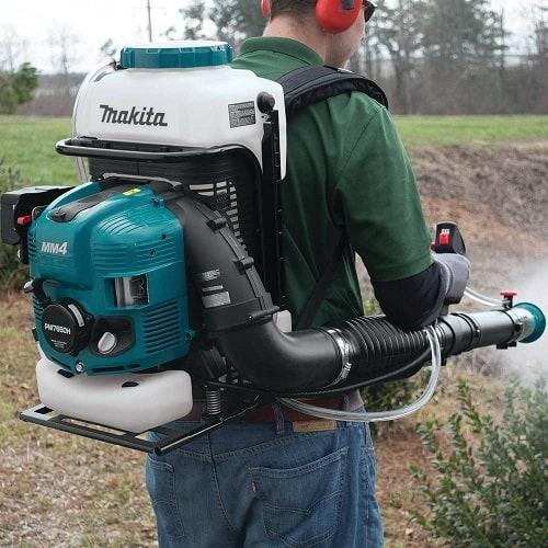 man using mosquito fogger