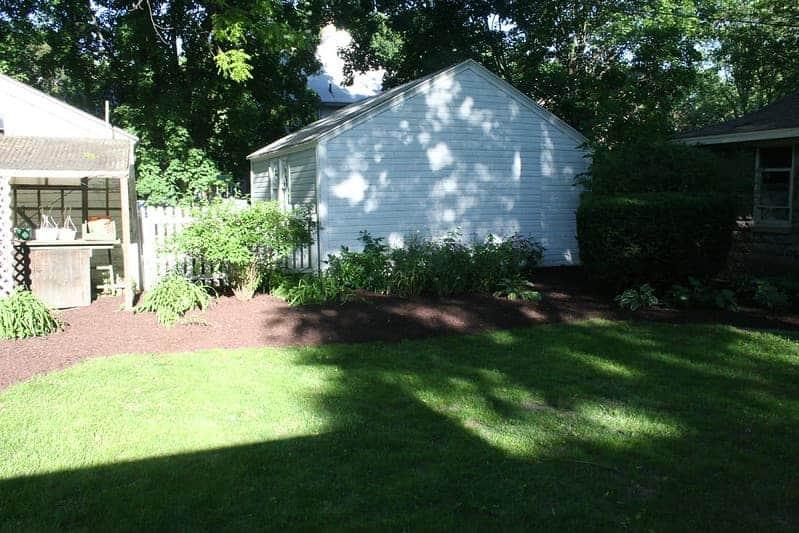 cozy back yard with a lawn