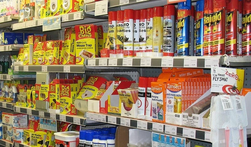 store shelf with a lot of insecticide bottles