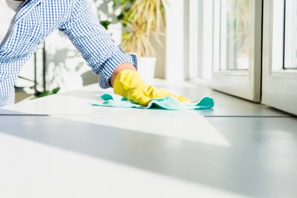 man cleaning his house